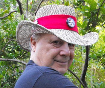Photo of E.J. Gold wearing Astral Travel Safari Hat with red band